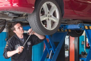 Close working on car, Complete Auto Repairs, 617 Hillside Road, Forbury Corner Dunedin, 03 455 3258
